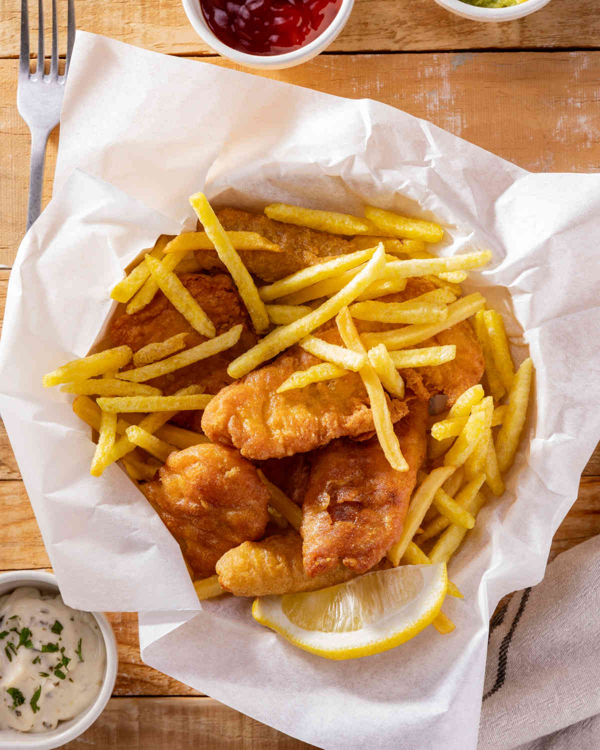 top-view-fish-chips-with-ketchup-sauce
